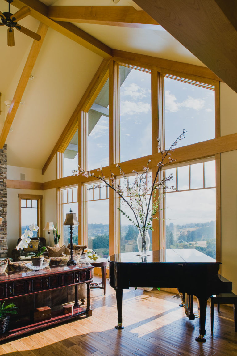 ceiling beams, hardwood floor, piano, fixed windows,