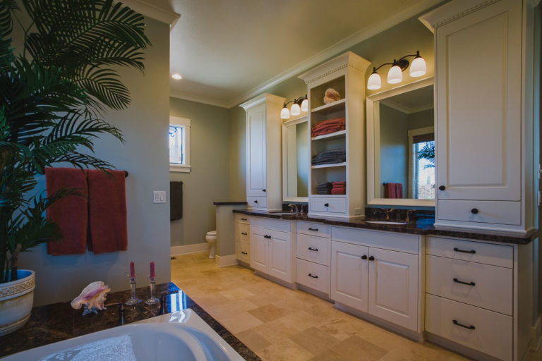 granite counter, master bath, framed mirror, cabinetry, lighting, crown molding
