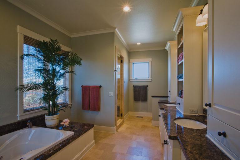 master bath, tile floor, spa tub, granite counter, cabinetry