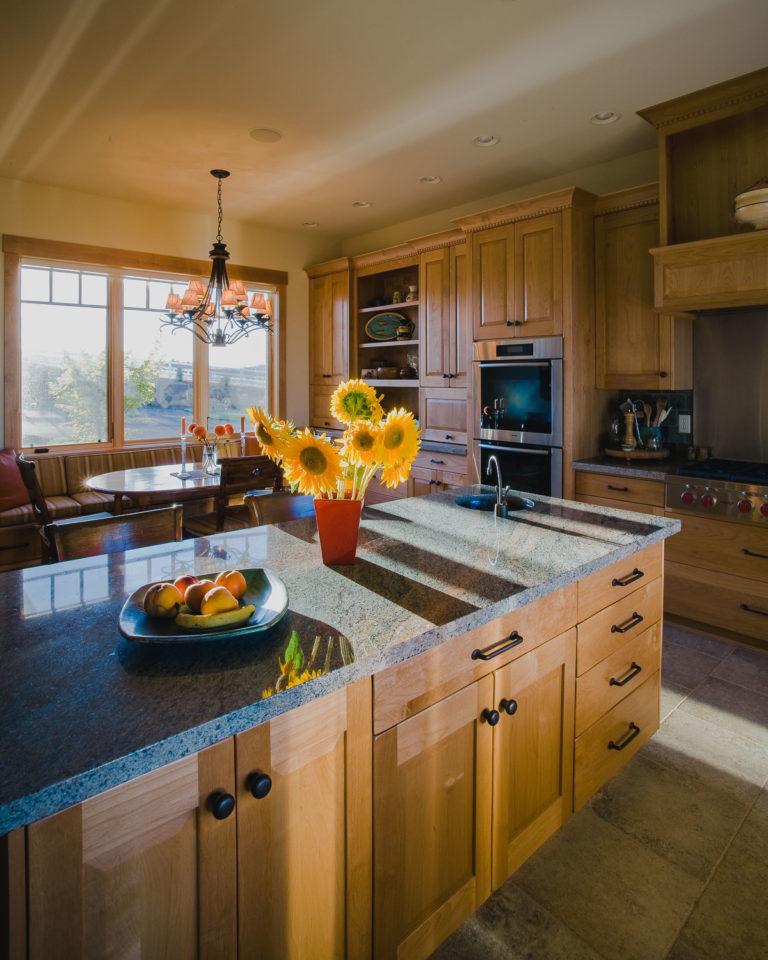 cabinetry, granite counter, tile floor, appliance