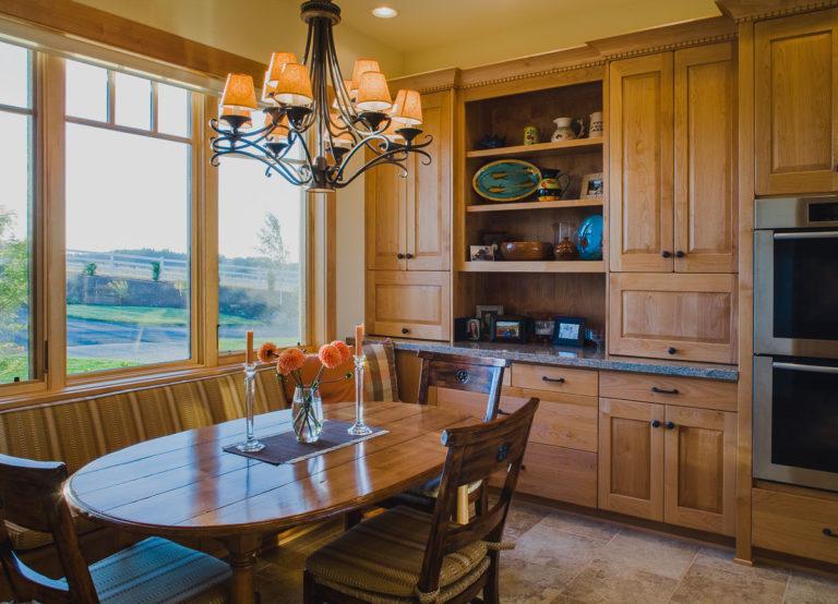 breakfast nook, cabinets, wood casement window, lighting