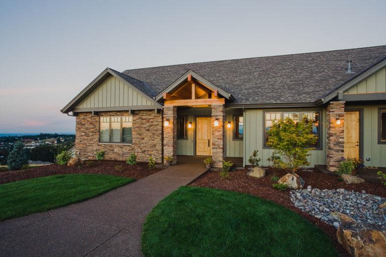 roof, exposed beams, Cultured Stone, exterior lighting, board & batten siding, aluminum clad wood windows