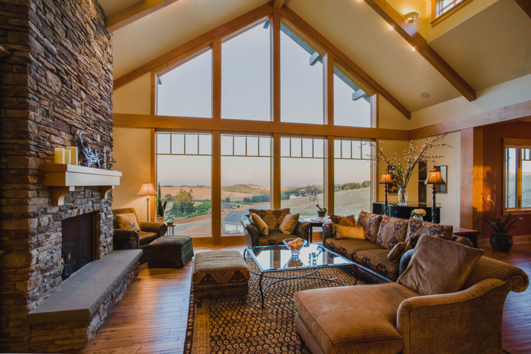picture window, stain grade woodwork, stone fireplace, wood mantel, stone hearth