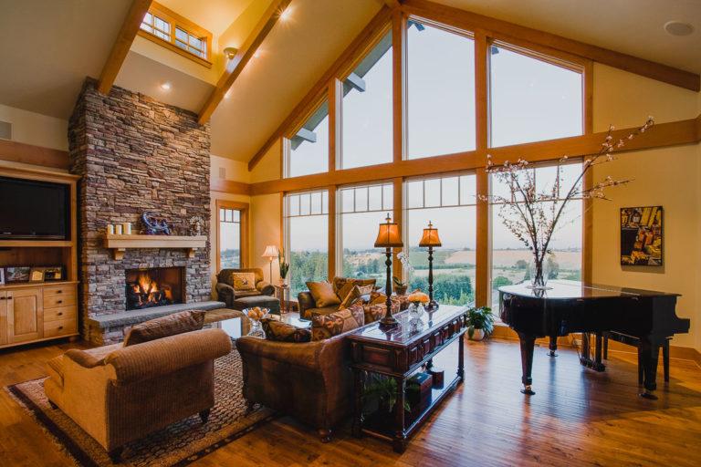 living room, piano, hardwood floor, stone fireplace, picture window, stain grade woodwork