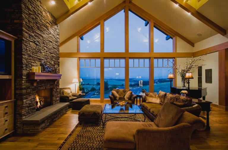 living room, picture window, stone fireplace, hardwood floor, window grills