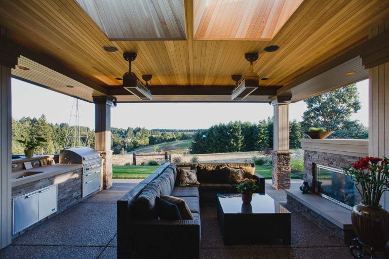covered pato, T&G cedar ceiling, outdoor kitchen, fireplace, exposed concrete, fireplace. cultured stone, lighting trough