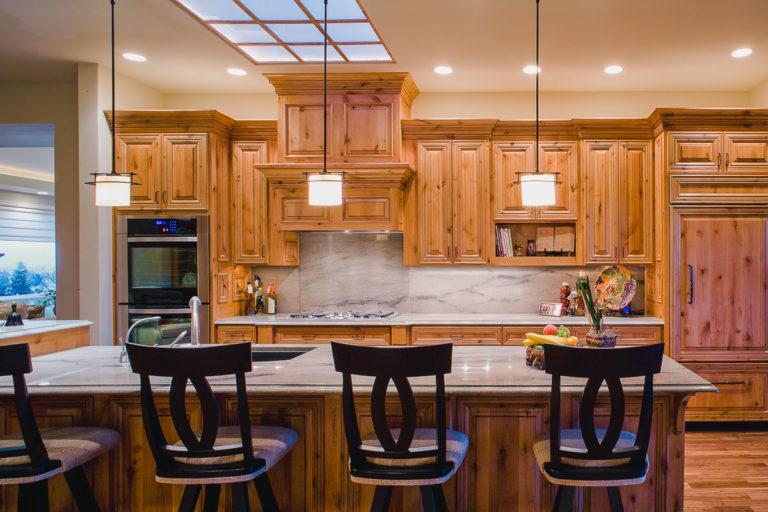 Kitchen, cabinets, granite counter, skylight grid, pendant lights, accent lighting, appliances