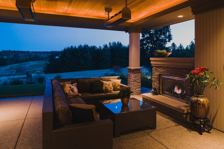 covered patio, fireplace, exposed aggregate concrete, T&G cedar ceiling, outdoor heater