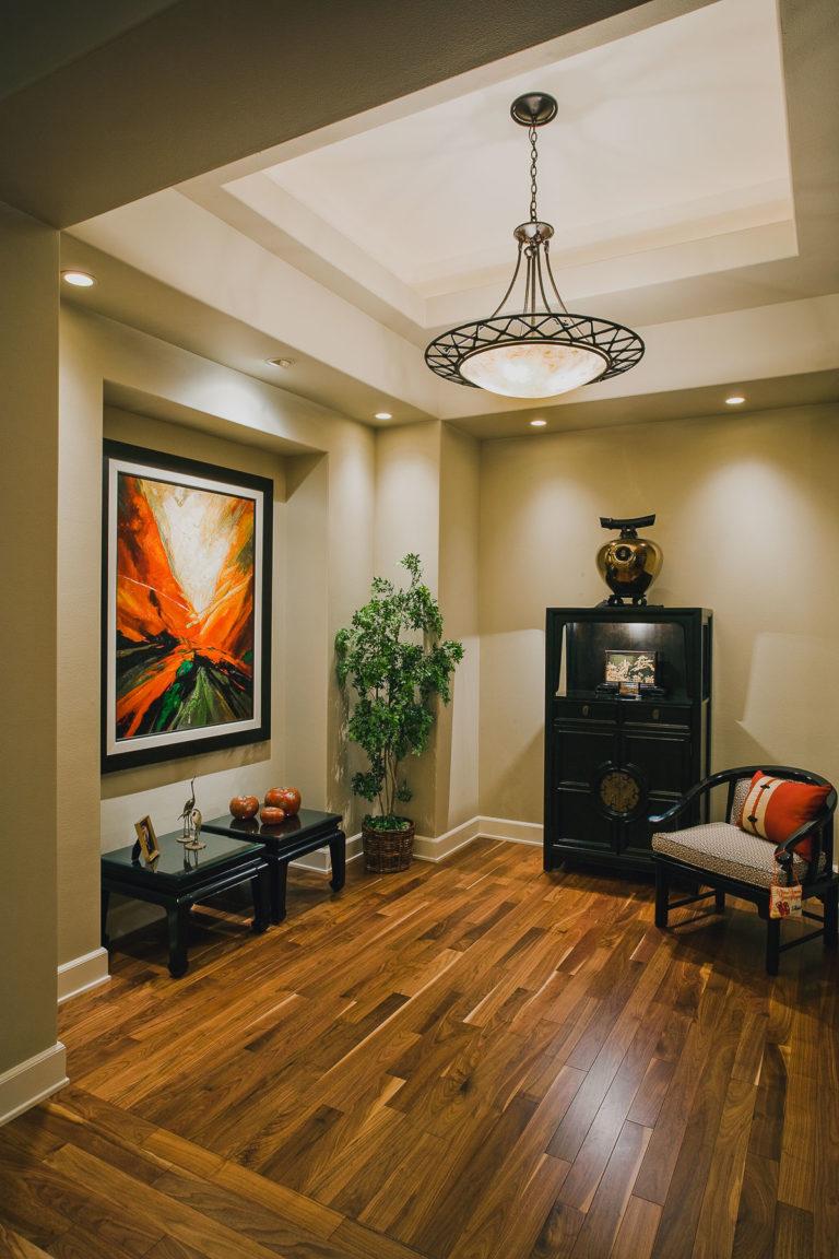 Foyer, walnut hardwood floor, lighting, light trough