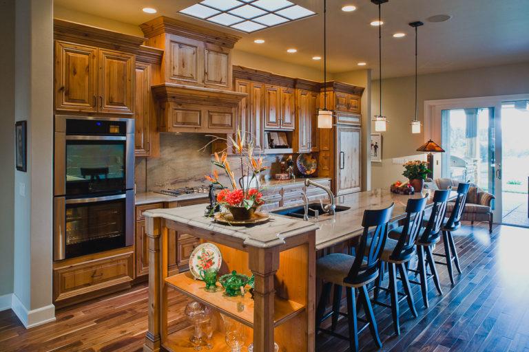 Kitchen, Cabinets, granite counter, appliances, skylight grid, walnut hardwood floor, pendant light, accent light