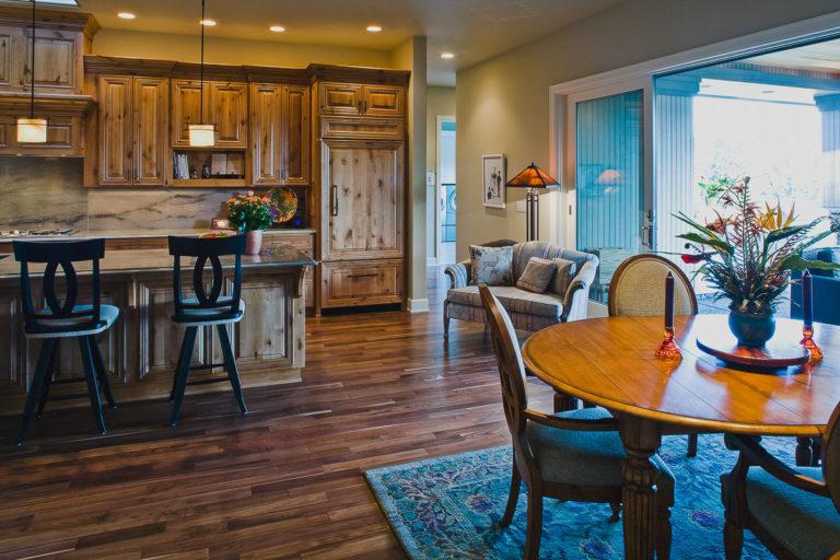 Kitchen, walnut hardwood floor, Andersen patio door, cabinet