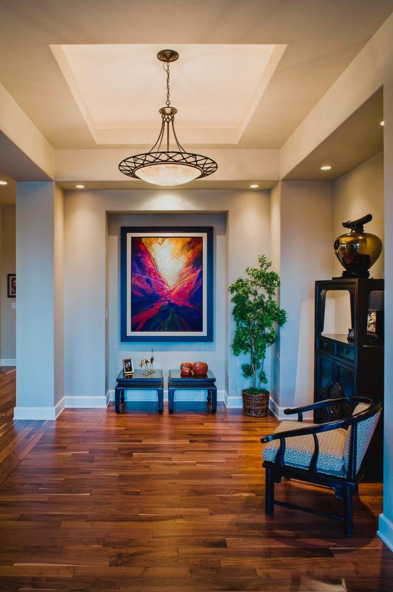 Foyer, walnut flooring, accent lighting