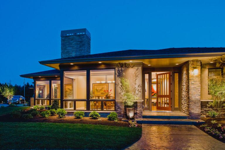 cultured stone veneer, T&G vertical siding, entry door, sidelights, exterior lighting, stamped concrete walk, Milgard fiberglass windows