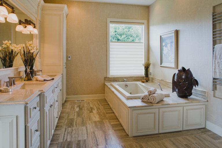 Master bath, vanity cabinet, spa tub, towel warmer, quartz counter, Travertine tile floor