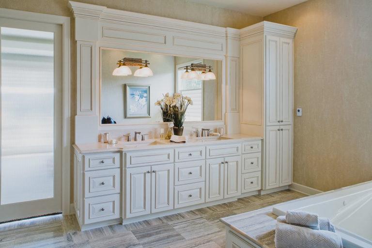 Master bath, Travertine tile floor, Quartz counter, mirror, vanity lighting, reeded glass door