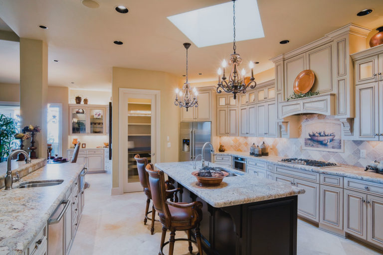 kitchen, cabinetry, antique brushed granite, tile splash, hand painted tile, appliance, lighting, skylight, pantry, cabinte glass, faucet, cabinet lighting